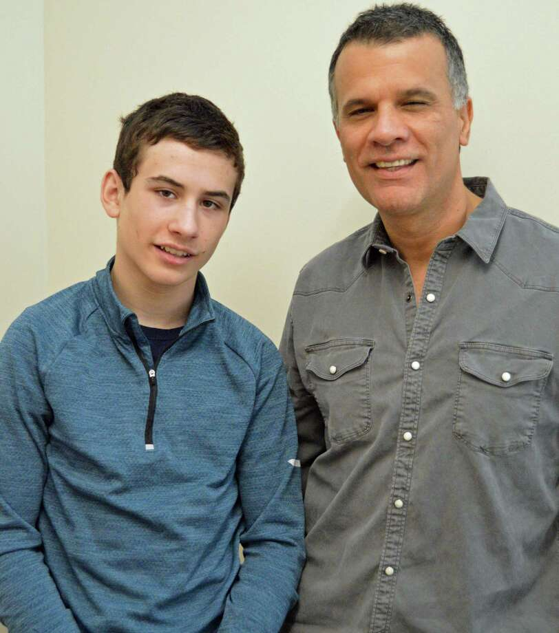 Ben and Larry Cruz, of Weston, will be climbing Rockefeller Center on March 3 to raise money for the National Multiple Sclerosis Society. Photo: Nicole Zappone / For Hearst Connecticut Media