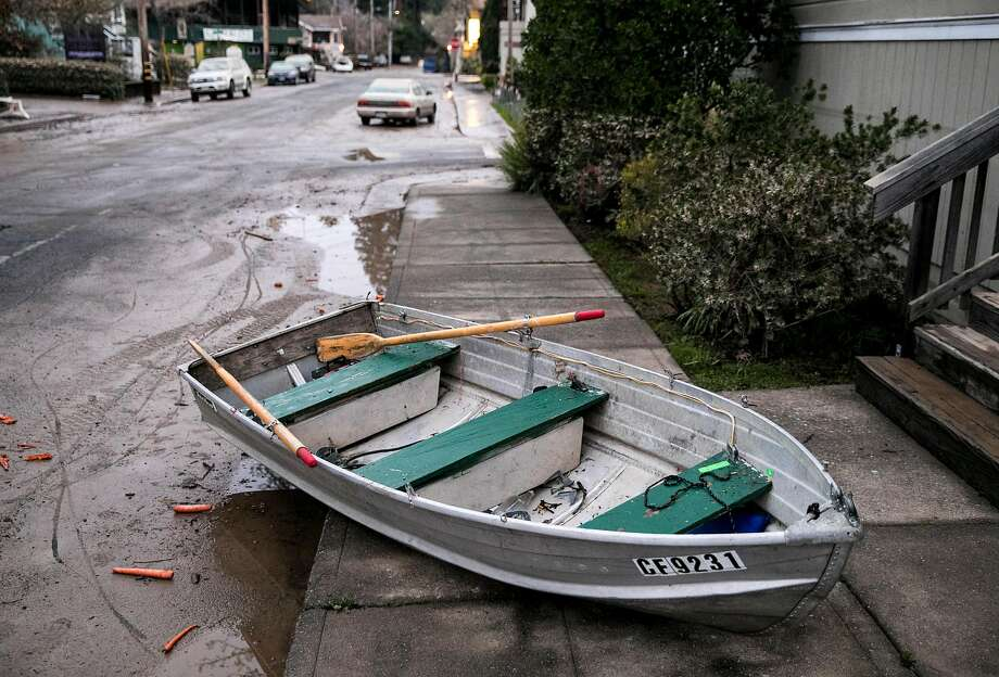 A boat is seen washed up on the sidewalk in front of a business along Mill Street after floodwaters from the Russian River receded overnight in Guerneville, Calif. Thursday, Feb. 28, 2019. Photo: Jessica Christian, The Chronicle
