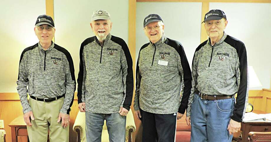 Members of the Cromwell High School girls basketball team have formed friendships in a mentorship program at the Covenant Village of Cromwell senior living community. From left are Jack Reisch, Bob Hoyt, Ray Kliewer and Dr. Duane Anderson. The men are wearing school pullovers, which are gifts from some of the players. Photo: Contributed Photo