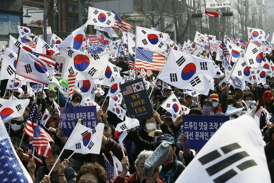 Protesters rally against President Moon Jae In's policies with North Korea in Seoul. They claim improved relations with the North could threaten South Korea's alliance with U.S. Photo: Ahn Young-joon / Associated Press