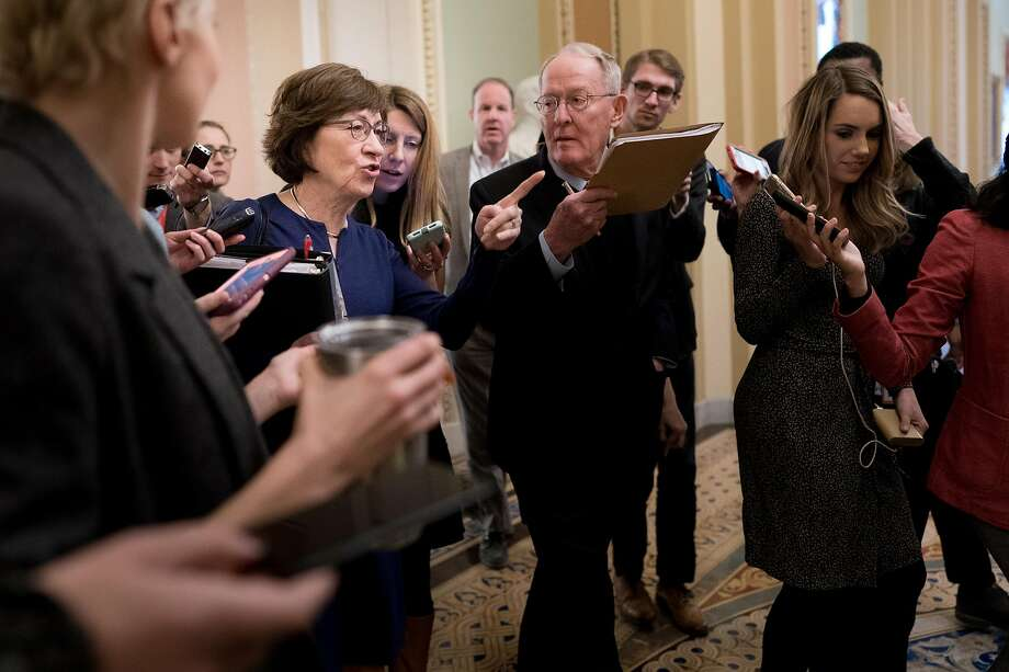 Sens. Susan Collins (center left), R-Maine, and Lamar Alexander, R-Tenn., are critical of the president's emergency declaration. Photo: Erin Schaff / New York Times