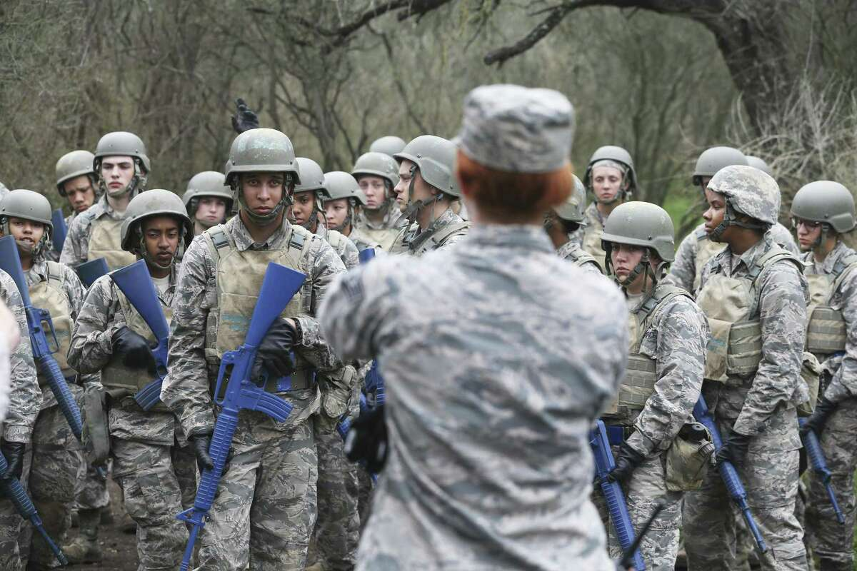 Trainees listen to instructions for crossing an obstacle as Joint Base San Antonio-Lackland trainees go through the CLAW obstacle course, part of the BEAST program in their basic military training on February 6, 2019.