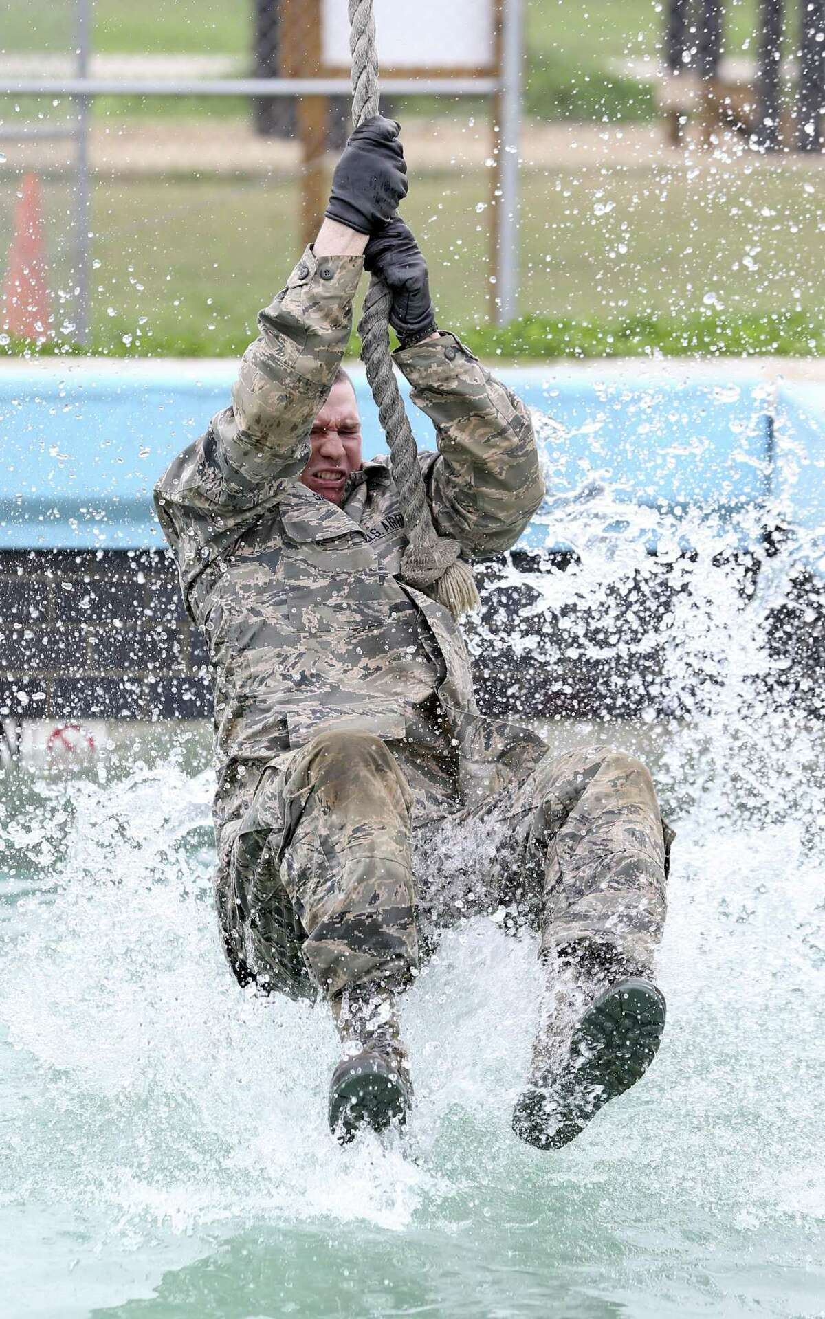 An Air Force recruit skims across the water in an exercise in the CLAW obstacle course, part of the BEAST program at Joint Base San Antonio-Lackland, on Feb. 6, 2019.