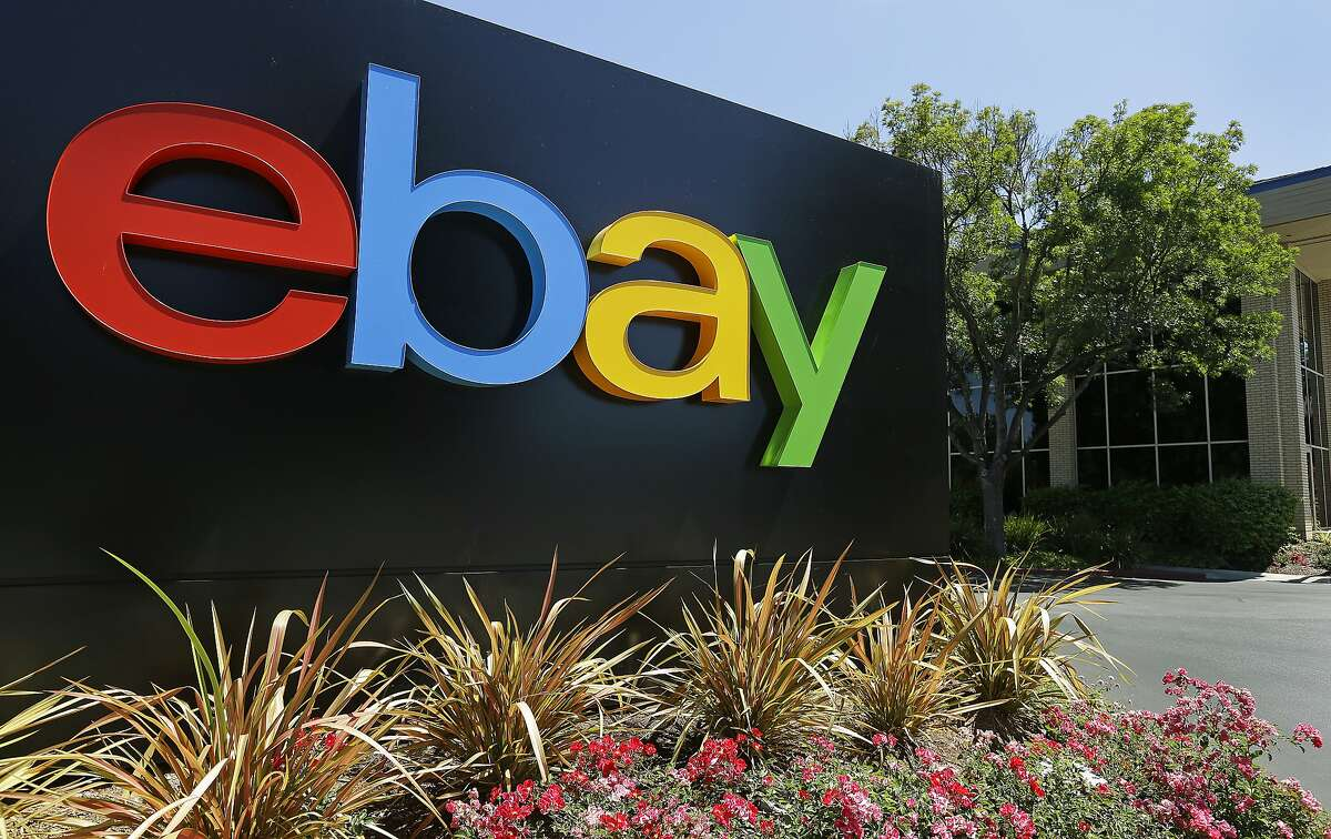 FILE - This Tuesday, July 16, 2013, file photo shows signage at eBay headquarters in San Jose, Calif.
