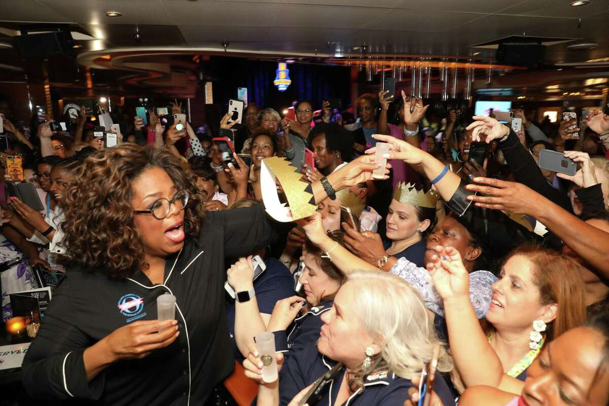 Oprah Winfrey hands out tequila shots at a pajama party during the cruise.