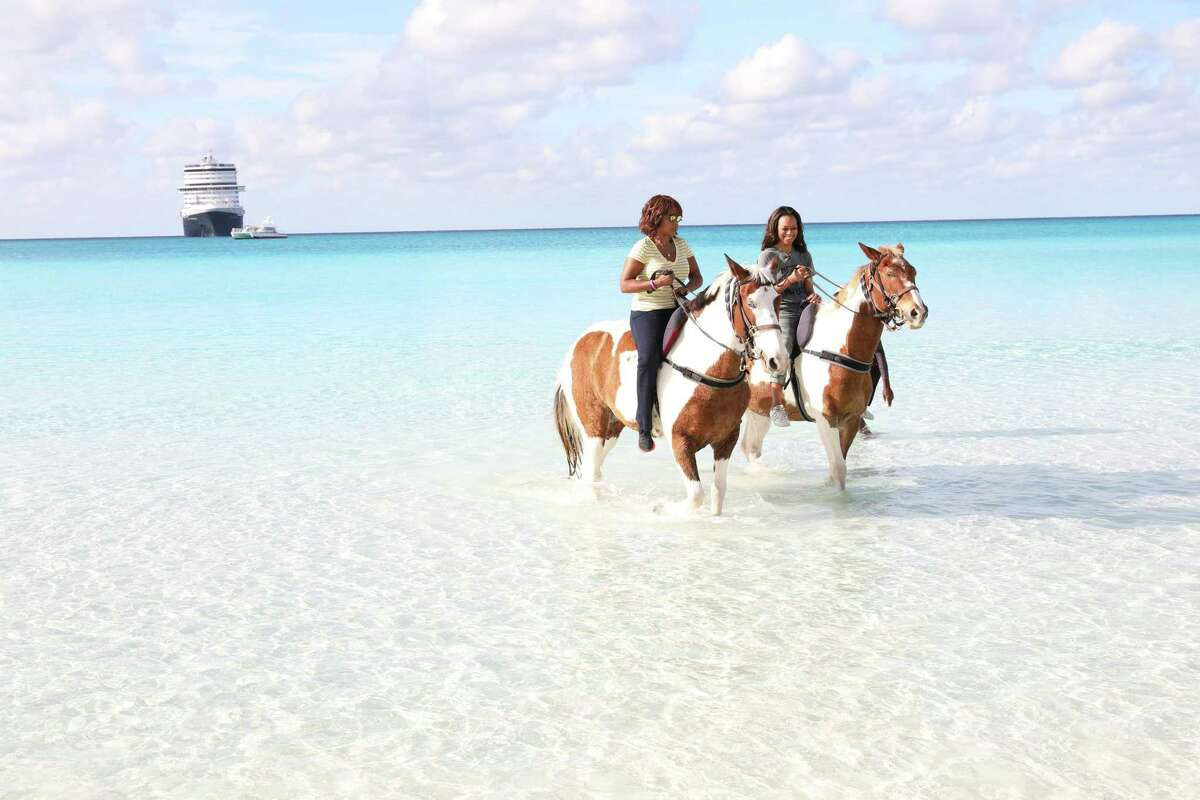 Entertainment Tonight's Nischelle Turner and Gayle King ride horses on the beach.