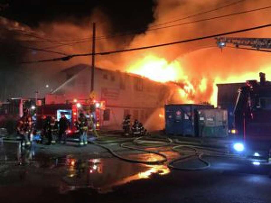 Seattle firefighters battle a 4-alarm fire at a lumberyard in north Queen Anne on Nov. 10, 2018. Prosecutors charged a man on Feb. 27 in connection with this and three other fires last year. Photo: Seattle Fire Department