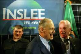 Washington State Governor Jay Inslee speaks with Jim Whittaker (left), an REI co-founders and the first American to summit Mount Everest, after announcing his candidacy for President of the United States, Friday, March 1, 2019 at A&R Solar in Mount Baker. He pledged to make climate change his number one priority.