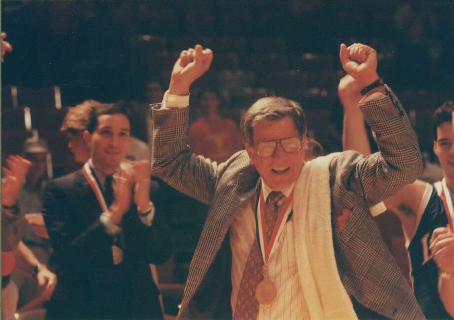 Clear Lake head coach Bill Krueger celebrates the Falcons' 1989 state championship win over San Antonio Jay. Krueger will receive a lifetime achievement award March 27 in Atlanta. Photo: SUBMITTED PHOTO / Submitted Photo