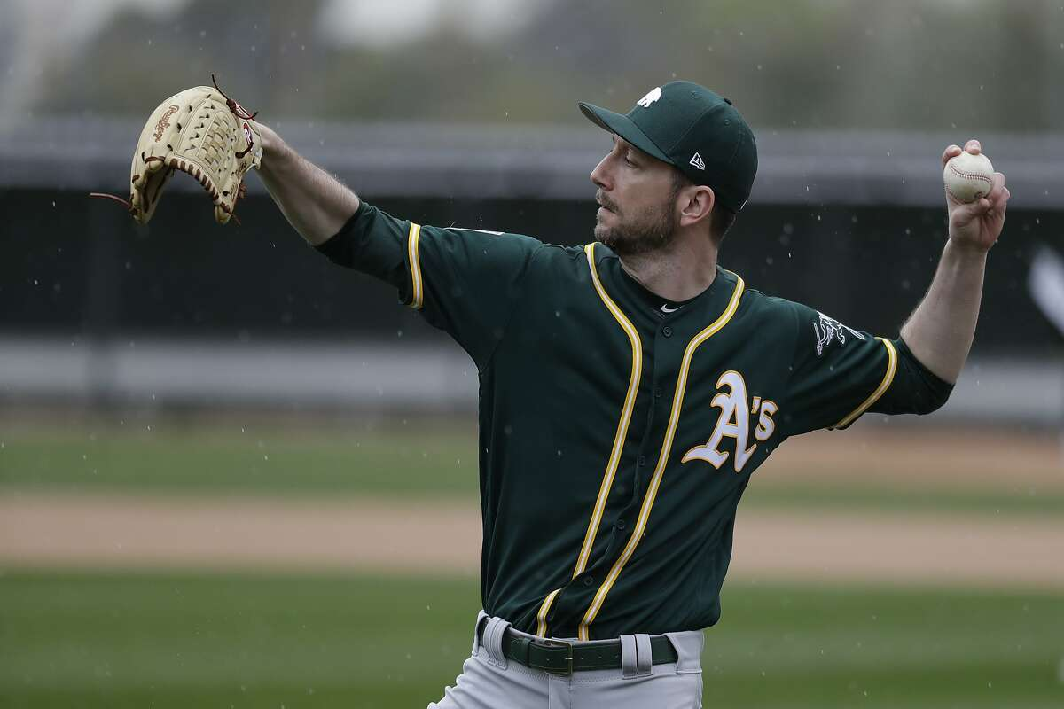 Oakland Athletics' Jerry Blevins throws at their spring baseball training facility in Mesa, Ariz., Thursday, Feb. 14, 2019. (AP Photo/Chris Carlson)