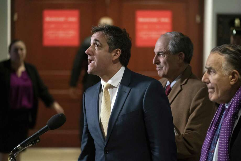 President Donald Trump's former lawyer, Michael Cohen, joined at right by his attorneys Lanny Davis and Michael Monico, leaves a closed-door interview with the House Intelligence Committee at the end of three days of congressional testimony on Capitol Hill in Washington, Thursday, Feb. 28, 2019. (AP Photo/J. Scott Applewhite) Photo: J. Scott Applewhite / Associated Press / Copyright 2019 The Associated Press. All rights reserved.