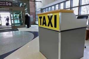 A view of a taxi information booth near the baggage claim area inside at the Albany International Airport on Thursday, Feb. 28, 2019, in Albany, N.Y.  (Paul Buckowski/Times Union)