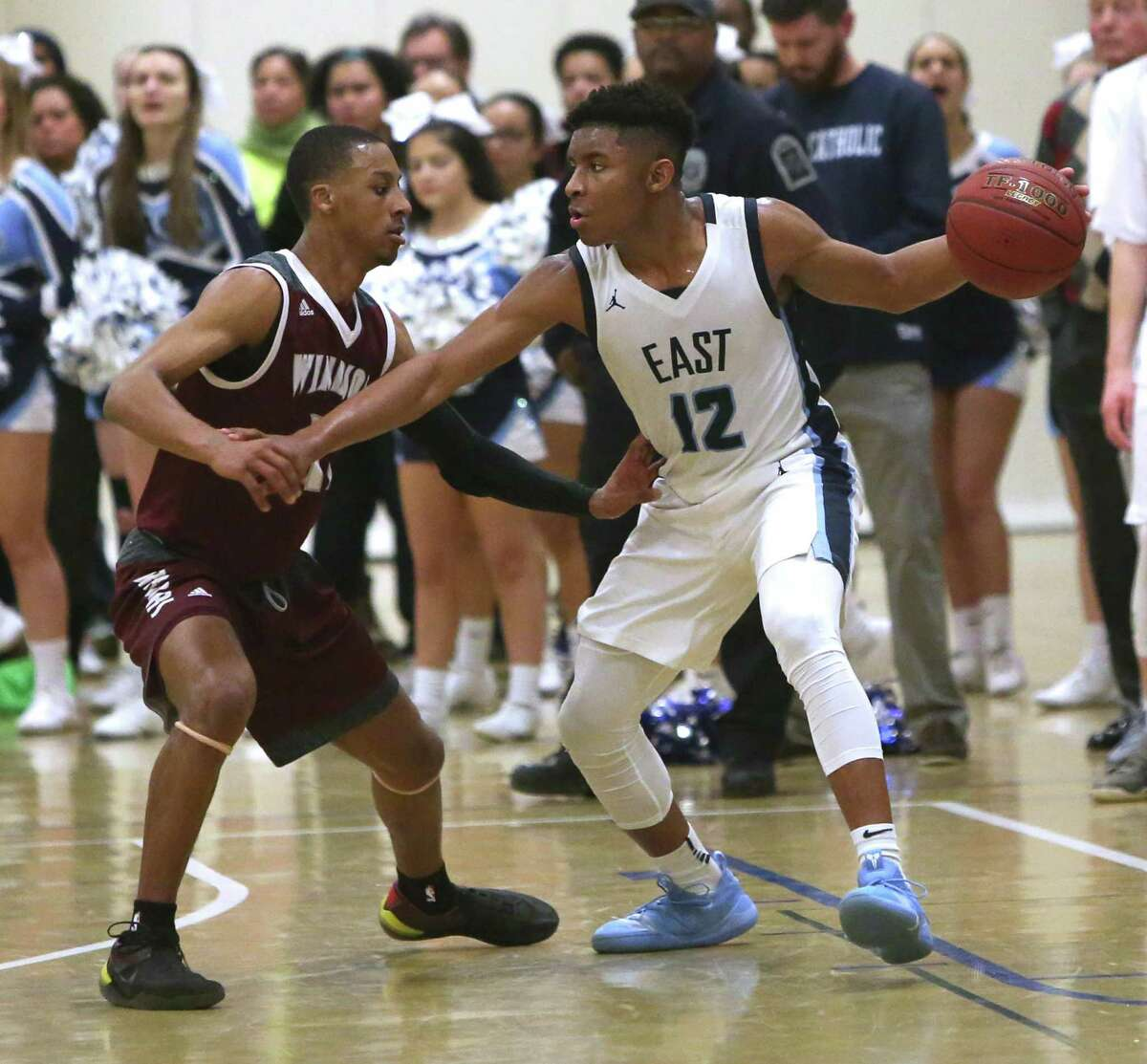 East Catholic's Jaylin Hunter looks for an open teammate against Windsor this past season.