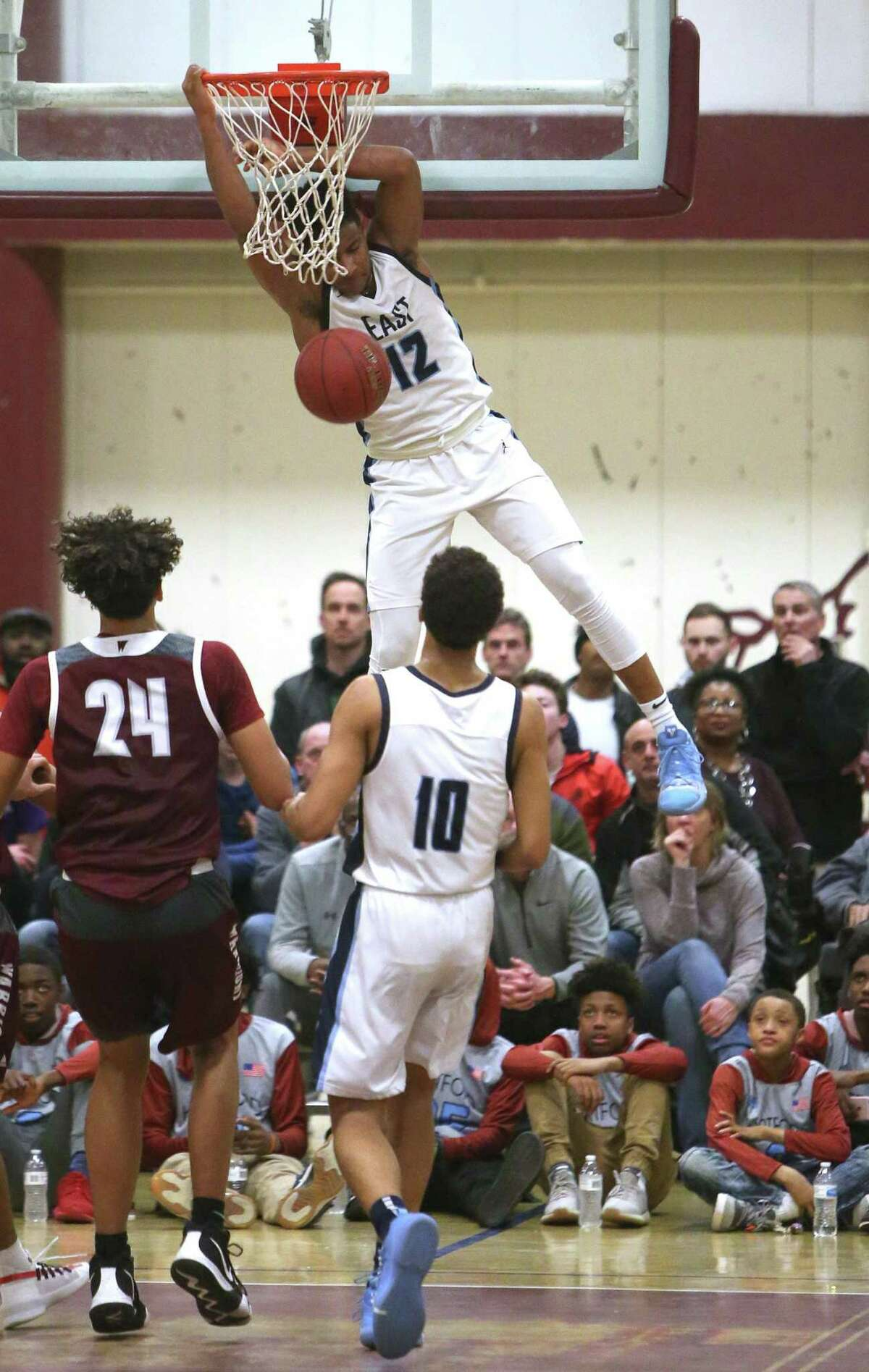 East Catholic's Jaylin Hunter dunks the ball during the CCC boys basketball tournament final against Windsor.