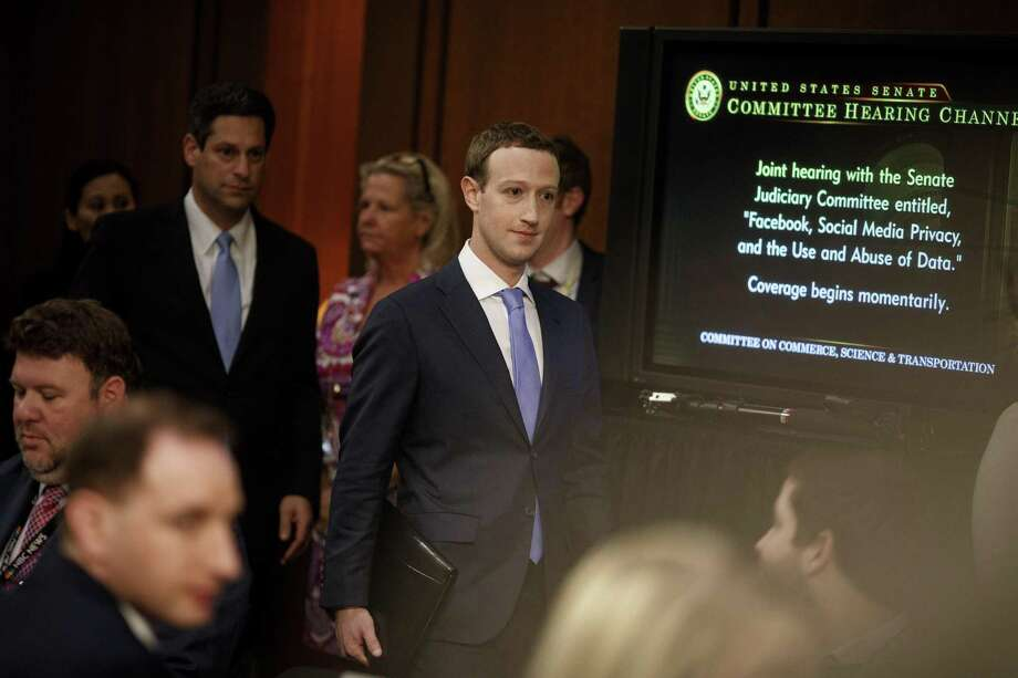 FILE — Mark Zuckerberg, Facebook's chief executive, arrives to testify on Capitol Hill in Washington, April 10, 2018. Thanks to intensive coaching and preparation, the company's communications team believed, Zuckerberg had effectively parried tough questions at the April hearing. But they worried he had come off as robotic -- a fear later confirmed by the company's polling. (Tom Brenner/The New York Times) Photo: TOM BRENNER, STF / NYT / NYTNS