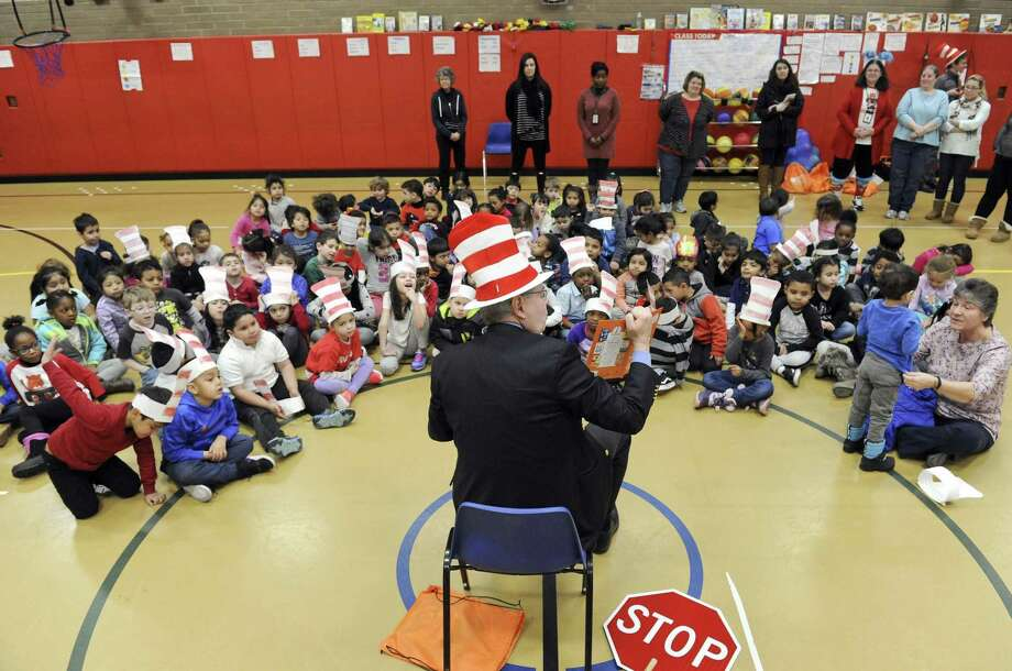 "Stamford Mayor David Martin reads ""Dr. Seuss Green Eggs and Ham"" to kindergarteners at Toquam Magnet School on March 1, 2019 in Stamford, Connecticut. This was the mayors second time participating in the National Education Association's Read Across America Day, which encourages more than 45 million readers, both young and old, to pick up a book and read. Photo: Matthew Brown / Hearst Connecticut Media / Stamford Advocate"