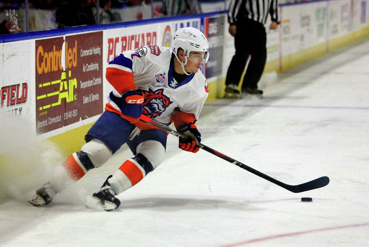 The Sound Tigers' Chris Bourque moves the puck against Providence on Dec. 2 at the Webster Bank Arena in Bridgeport.