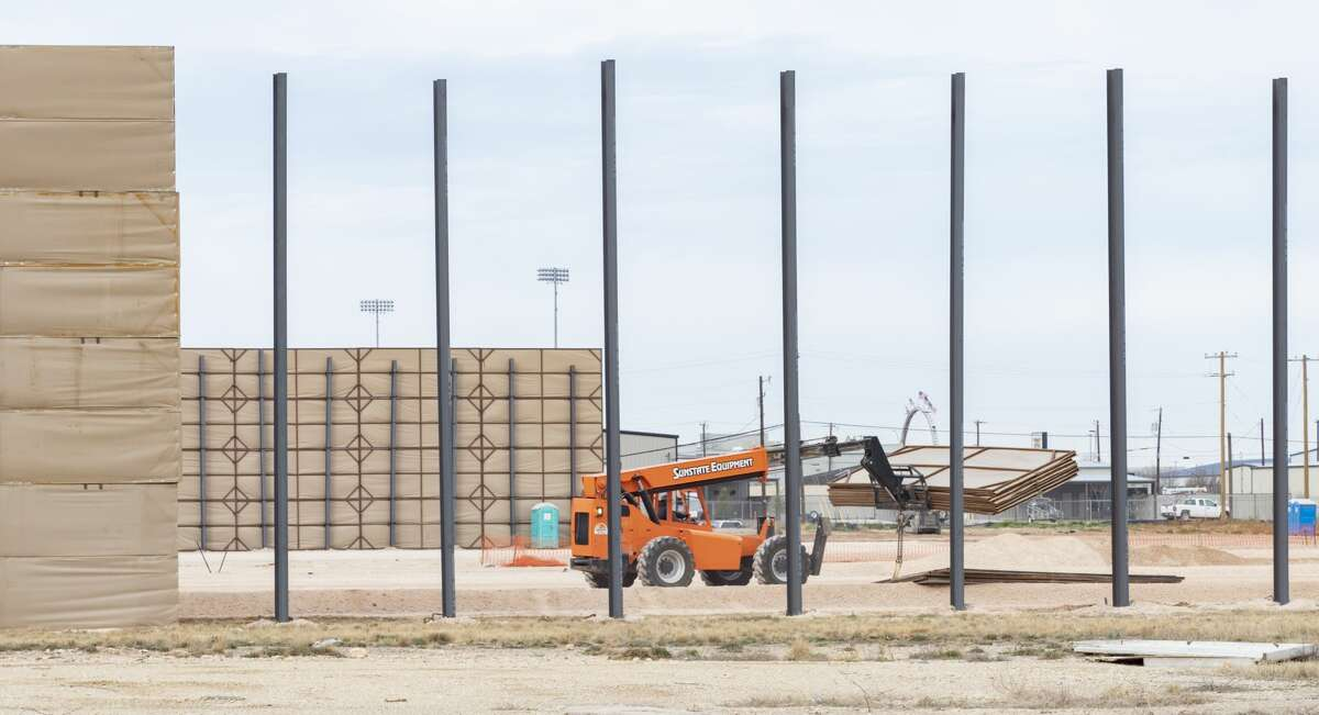 A large barrier was under construction Wednesday off North Brentwood Drive near House Park to ease noise and dust for a Fasken Oil and Ranch drilling rig.