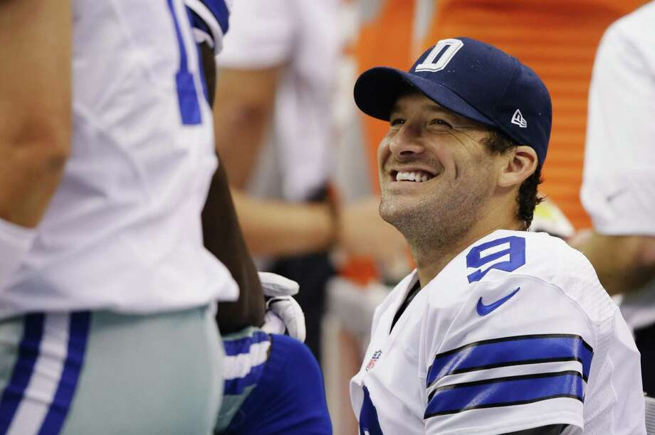 Dallas Cowboys quarterback, Tony Romo, talks with teammates on the sideline during the fourth quarter of a NFL football game against the St. Louis Rams, Sept. 22, 2013, in Arlington. A reader says the lack of Latino pro athletes is not due to lack of talent but, rather, lack of physicality required for certain sports. Photo: Tony Gutierrez /AP / AP