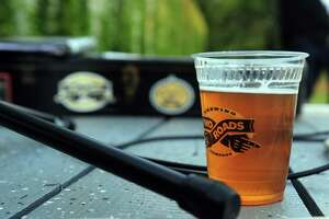 Two Roads Brewing Company held its Hopyard Concert Series event featuring guitarist Jon Slow opening the evening and later Hitch and the Giddyup performed at the brewery in Stratford, Conn., on Friday Aug. 28, 2015. The brewery also featured its newest beer: Field Yield Pale ale, which was made with estate grown cascade and centennial hops. The hops were on prominent display along one end of the yard serving as a backdrop for the concert. Along with the new beer, there were food trucks, bocce ball and cornhole games set up.