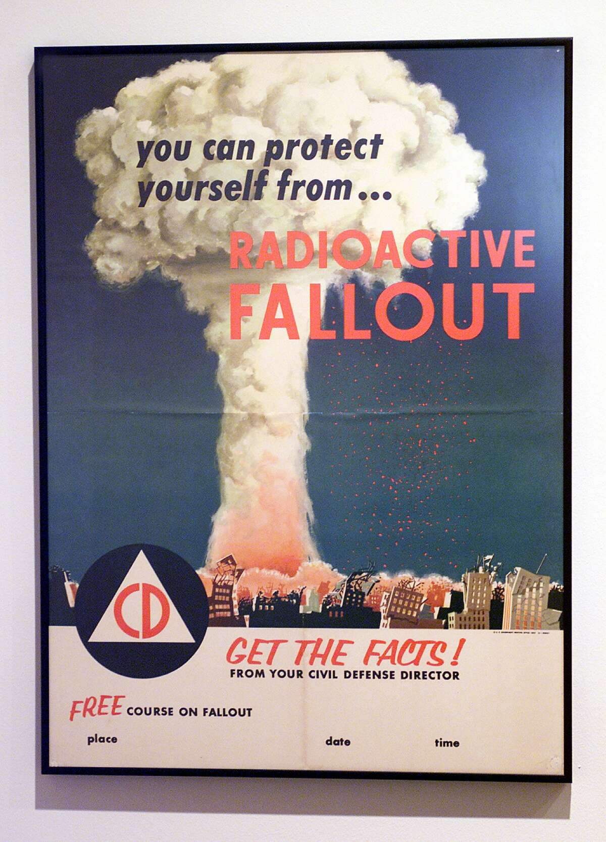 A fallout warning poster from the 1950s on exhibit at The University Museum in Los Angeles.