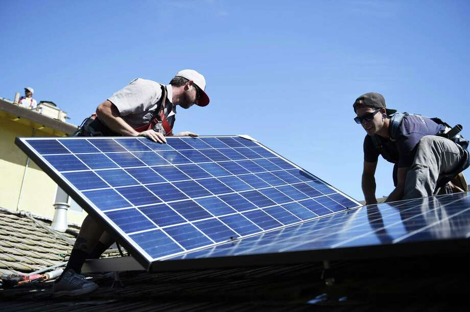Solar panels are installed on a home in Sunnyvale, Calif. San Antonio should follow California's example and require solar panels on all new homes. Photo: San Francisco Chronicle File Photo / **MANDATORY CREDIT FOR PHOTOGS AND SFCHRONICLE/NO SALES/MAGS OUT/TV