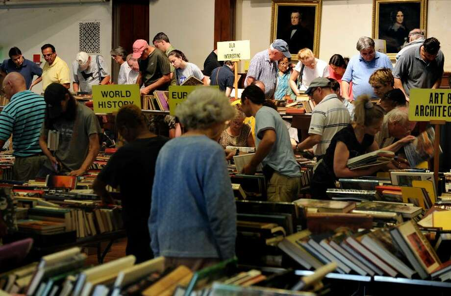 Collectors, dealers and book-lovers scour the Pequot Library's 50th annual book sale on opening day Friday July 23, 2010. Photo: Autumn Driscoll / Connecticut Post