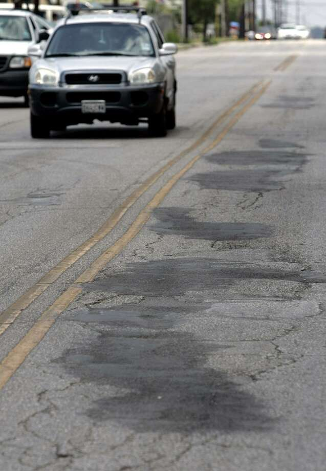Patched potholes dot Blanco Road. A reader urges the city to invest money in improvings roads and other urgent needs rather than expanding San Pedro Creek. Photo: William Luther /Staff File Photo / © San Antonio Express-News