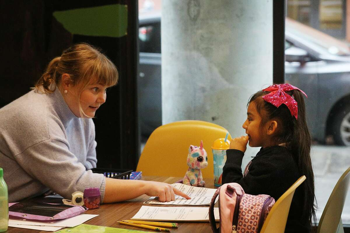 Volunteer tutor Natalie Skinner (l to r) works with Gigi, 6, during after school tutoring at 826 Valencia Mission Bay on Tuesday, February 26, 2019 in San Francisco, Calif.