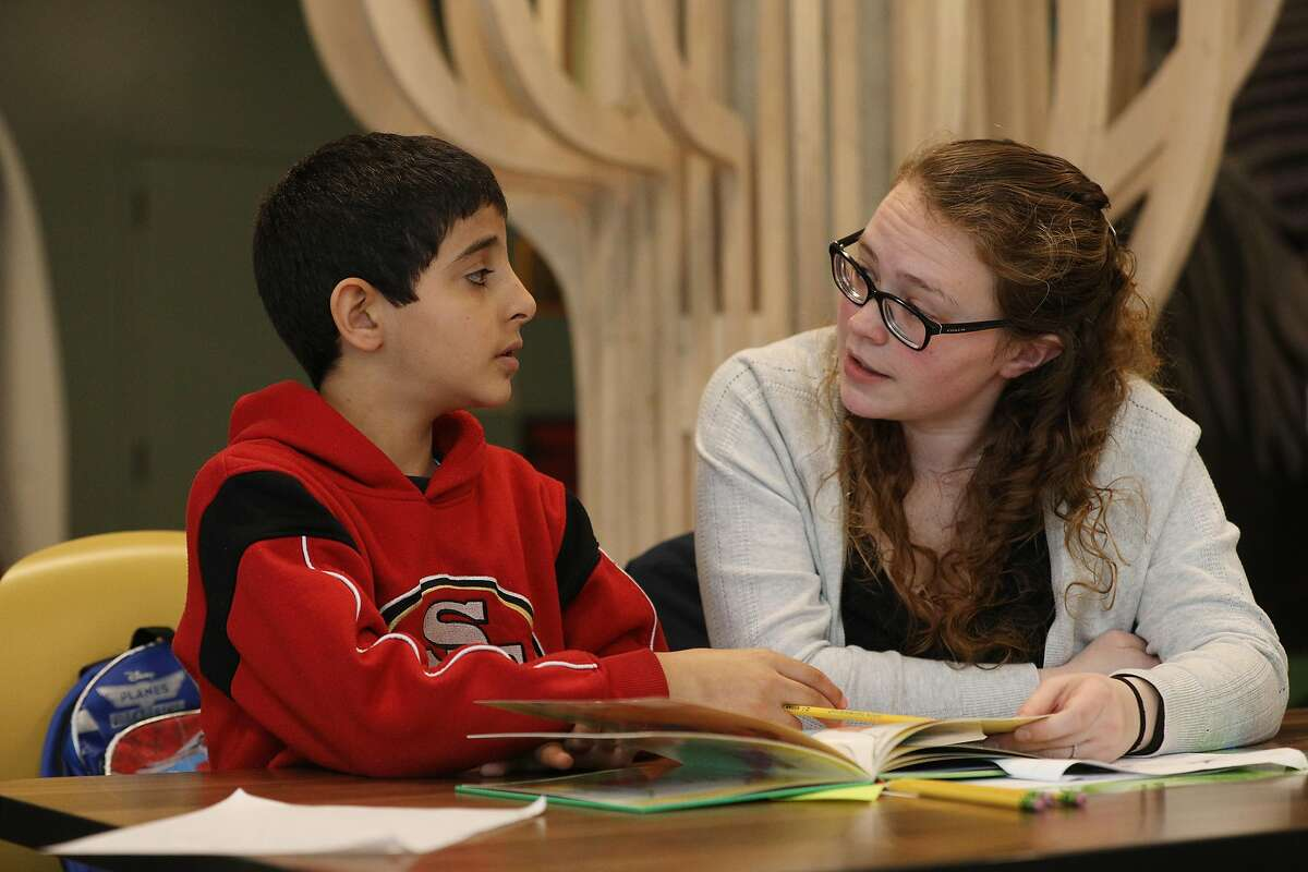 Volunteer tutor Shelby DeWeese (right) works with Salman (left), 8, during after school tutoring at 826 Valencia Mission Bay on Tuesday, February 26, 2019 in San Francisco, Calif.