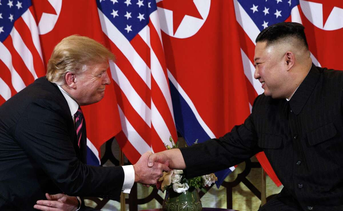 U.S. President Donald Trump shakes hands with North Korean leader Kim Jong Un in Hanoi. Trump said he walked away from his second summit with North Korean leader Kim Jong Un because Kim demanded the U.S. lift all of its sanctions, a claim that North Korea's delegation called a rare news conference in the middle of the night to deny.