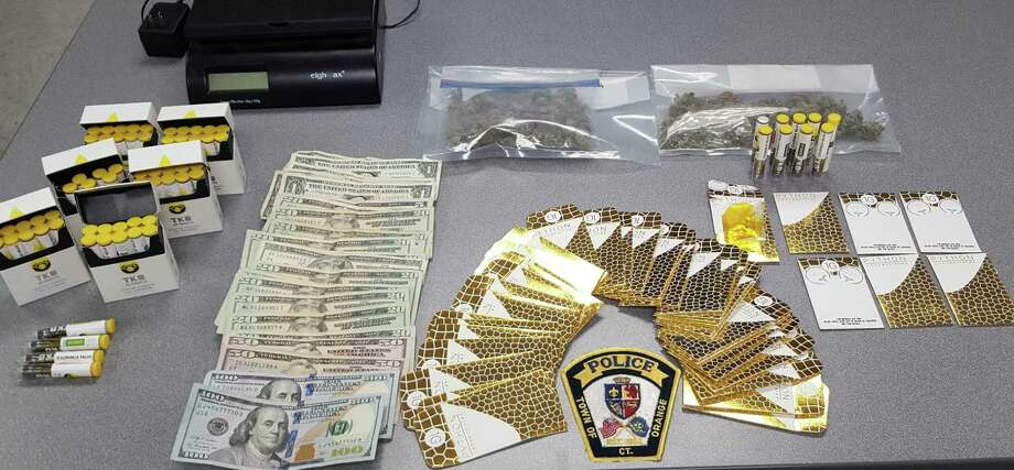 Orange police said they seized 102 grams of marijuana, Oxycodone pills, 41 grams of THC wax folds, 69 cartridges of THC oil, packaging and weighing materials, $573 in cash, eight cell phones from a Manley Heights Road home. Photo: Orange Police Department /