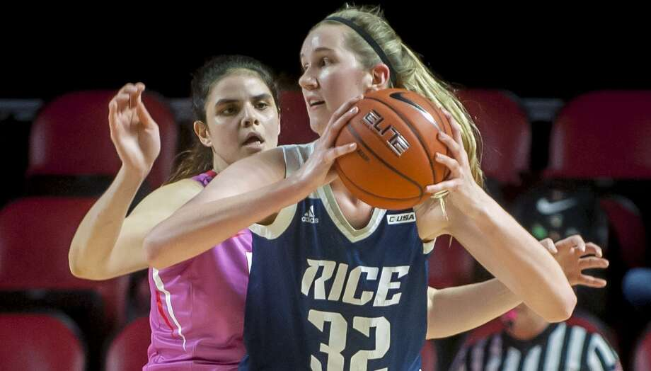 Rice center Nancy Mulkey, posting up against Western Kentucky forward Raneem Elgedawy, has come a long way to be the Owls starting center. Photo: Bac Totrong, MBI / Associated Press / Daily News