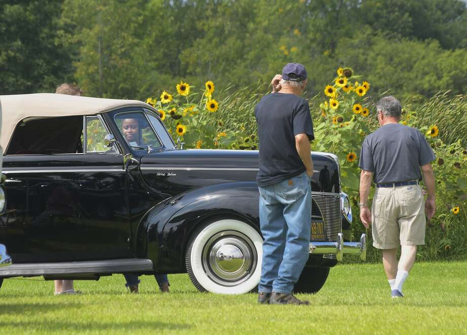 Visitors look over a 1940 Ford Deluxe at a classic car and truck show in Ballston Lake, N.Y., in August. Photo: Paul Buckowski / Hearst Newspapers 2018
