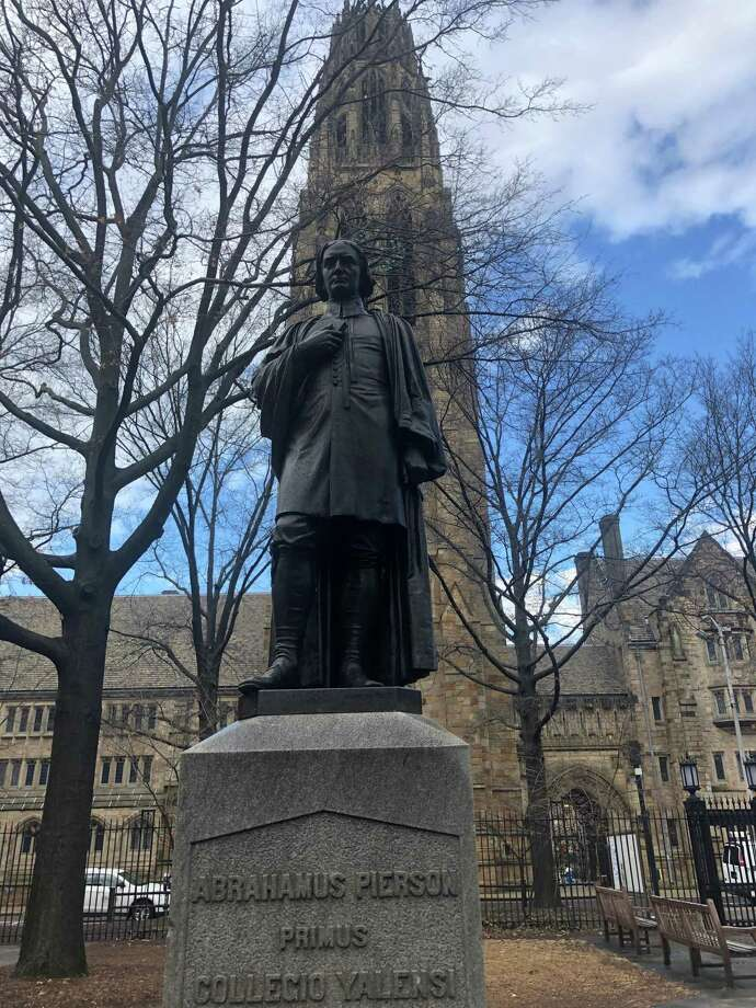 A statue of the Rev. Abraham Pierson in the Old Campus quad at Yale University in New Haven, Connecticut. Pierson, 1646-1707, was the first rector (1701-07) and one of the founders of the Collegiate School, which later became Yale University. Harkness Tower is behind Pierson. Photo: Ed Stannard / Hearst Connecticut Media