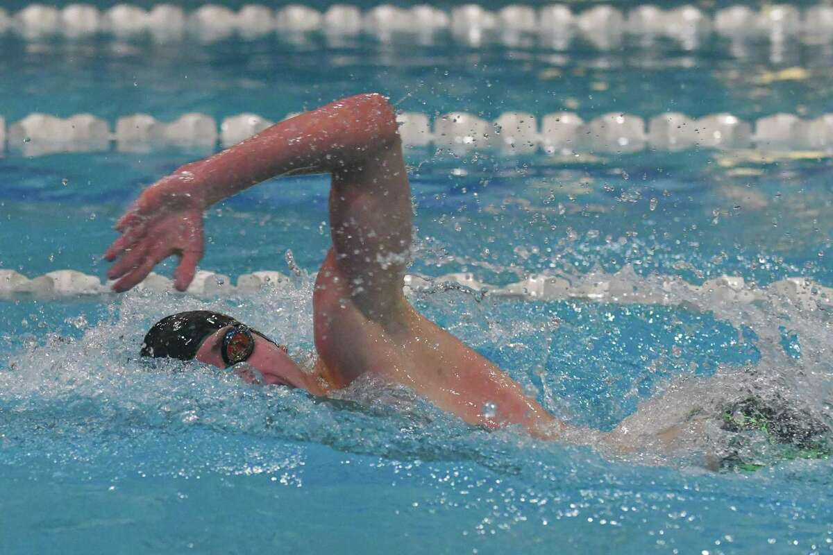Pomperaug's William Regan of Pomperaug swims to victory in the 200-yard freestyle Friday.