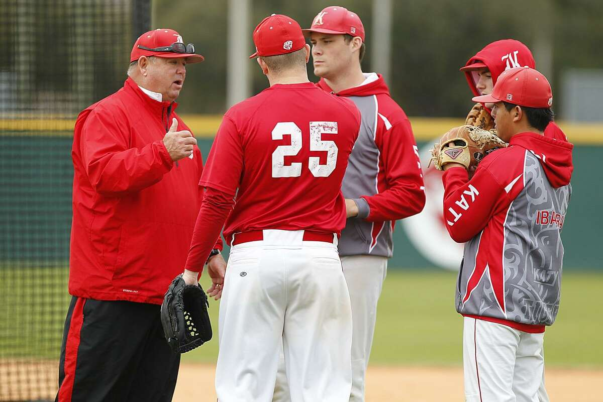 Katy baseball coach Tom McPherson gives instructions to his players as he goes through practice drills with varsity and JV at Katy High School.