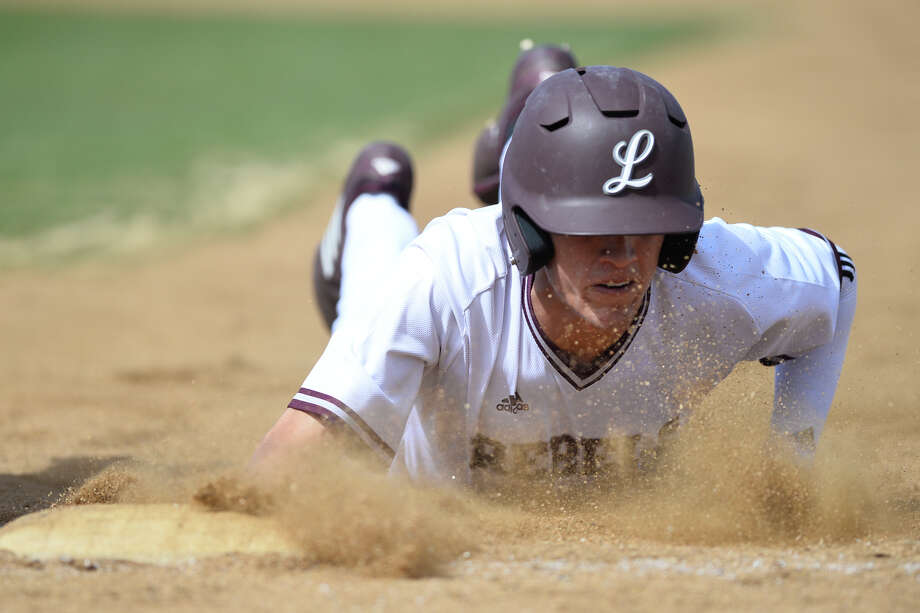 Lee's Logan Acosta beats the tag out at first from El Paso Americas in the Tournament of Champions March 1, 2019, at Ernie Johnson Field.  James Durbin/Reporter-Telegram Photo: James Durbin / ? 2019 Midland Reporter-Telegram. All Rights Reserved.