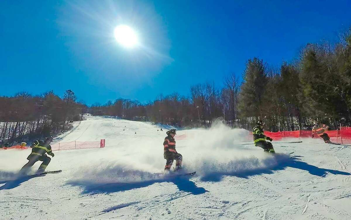 Firefighters race down the hill at Mohawk Mountain Ski Area in Cornwall during the 2018 Firefighter Race. The event, which benefits the Connecticut Burn Center at Bridgeport Hospital, will be held Sunday, March 10.