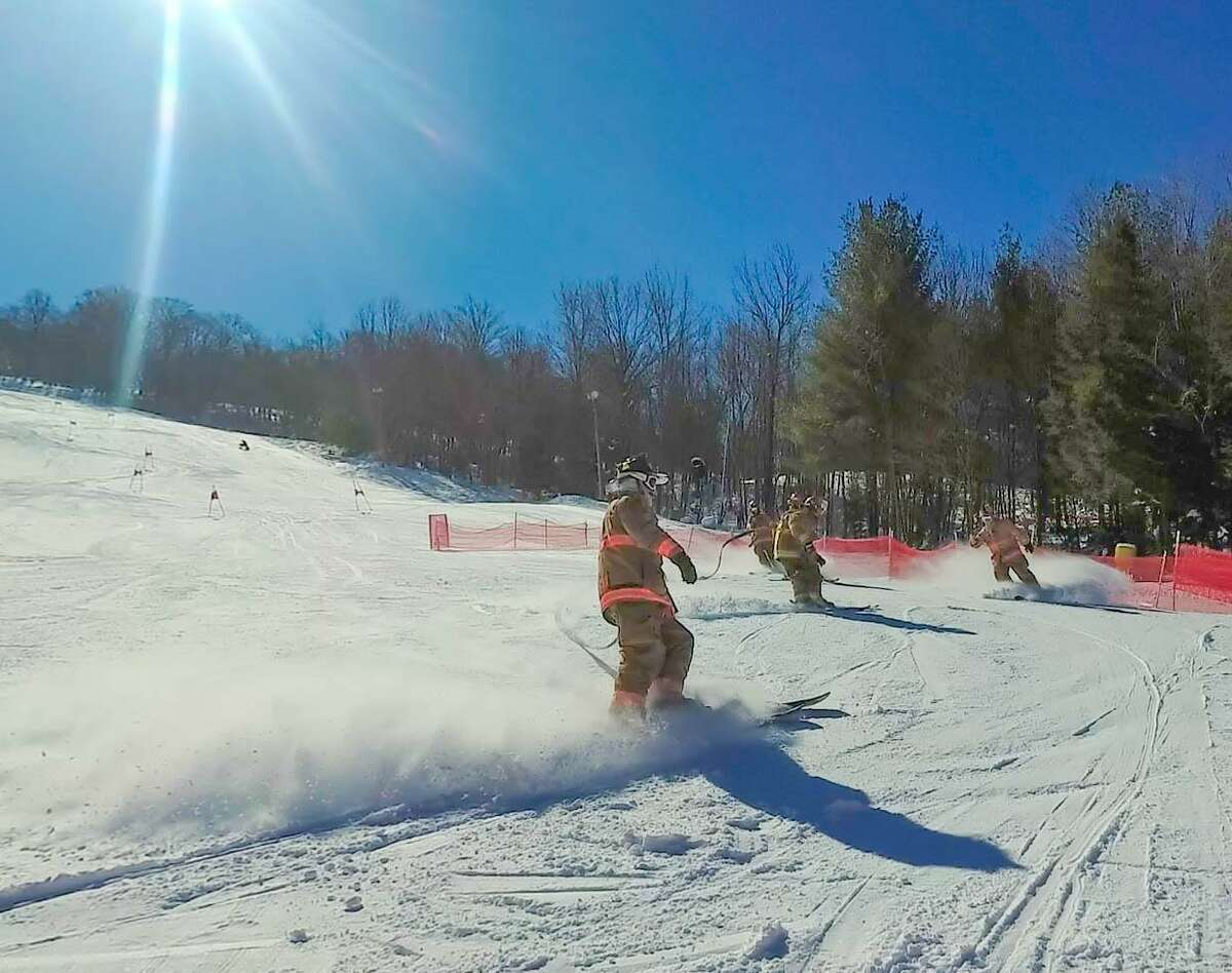 Skiiers make the powder fly at Mohawk Mountain Ski Area in Cornwall during the 2018 Firefighter Race. The event, which benefits the Connecticut Burn Center at Bridgeport Hospital, will be held Sunday, March 10.