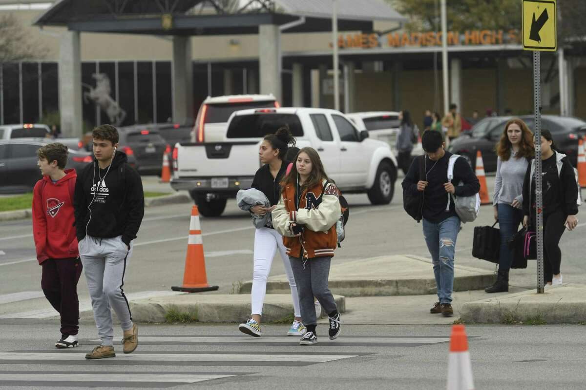 Students leave James Madison High School on Friday.