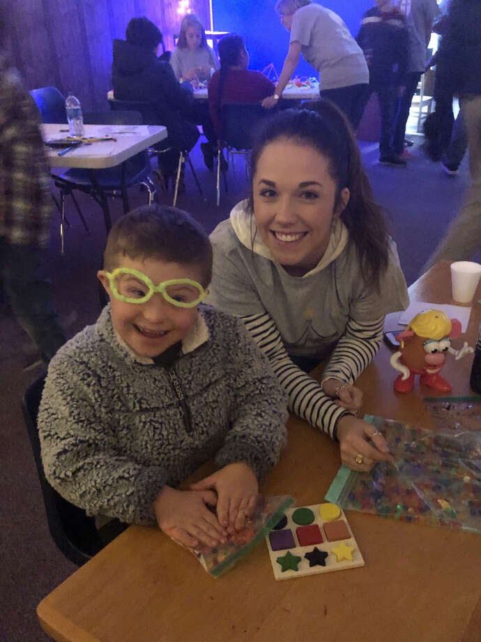 Brax Barnett and Wayland Baptist University student, Britney Levy, enjoy some fun crafts during RADAR Foundations Sensory Santa event in December. The event was the inspiration for a partnership between RADAR Foundations and the Hale County Literacy Council to offer a monthly Sensory Friendly Reading Night. The event will feature dimmed lighting and an environment free of noise and general chaos so that special needs children and their families can enjoy a family reading night, receive free books from HCLC and take advantage of a question/answer session with RADAR Foundation staff. Photo: Richard Porter/Courtesy Photo