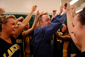 Bullock Creek coach Justin Freeland leads his team in a halftime cheer during halftime of the Lancers' regional semifinal vs. Corunna on Feb. 28, 2008.