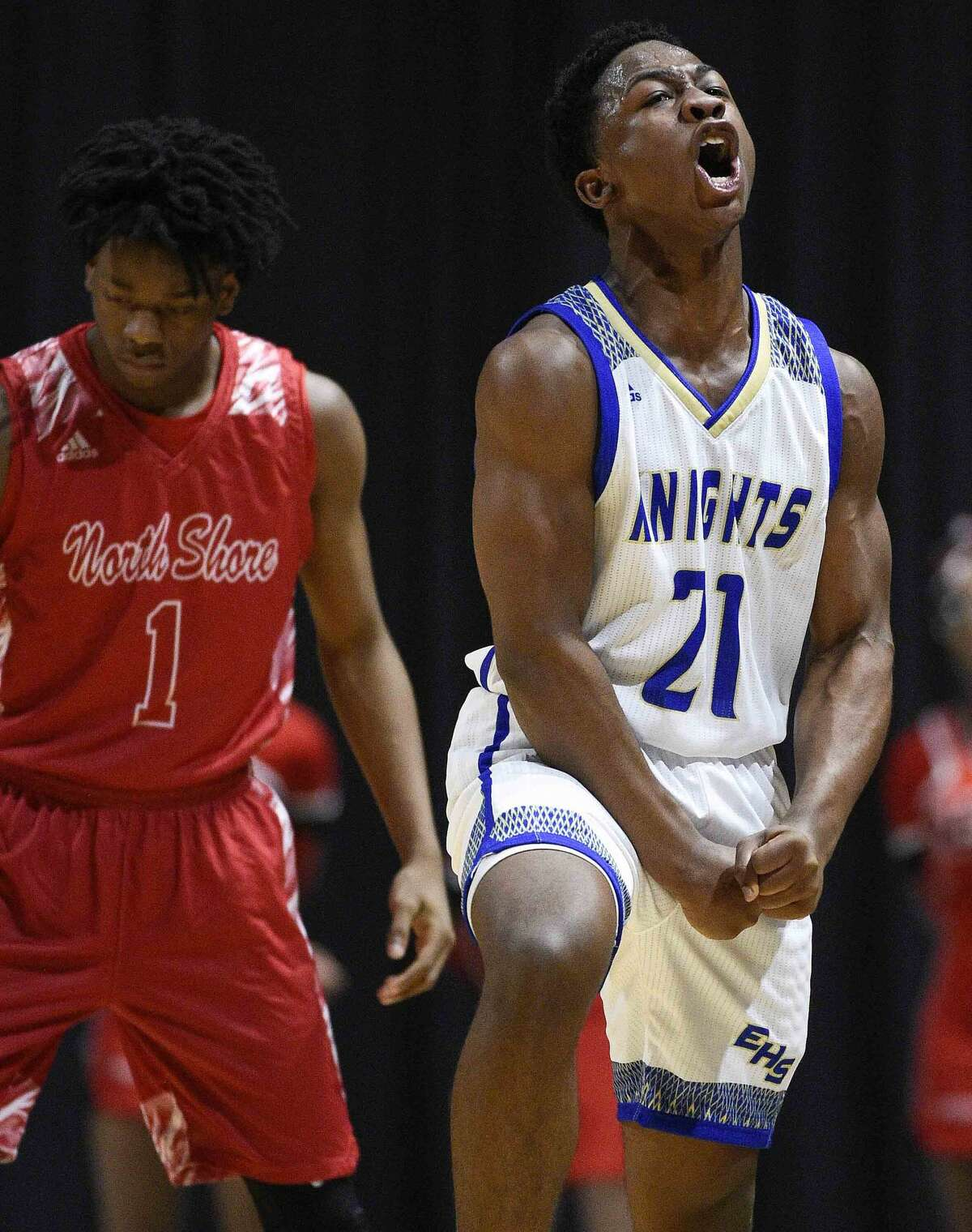 Elkins guard Jacob Harris, right, reacts after a North Shore turnover during the second half of a 6A regional semifinal high school basketball game, Friday, March 1, 2019, in Cypress, TX.