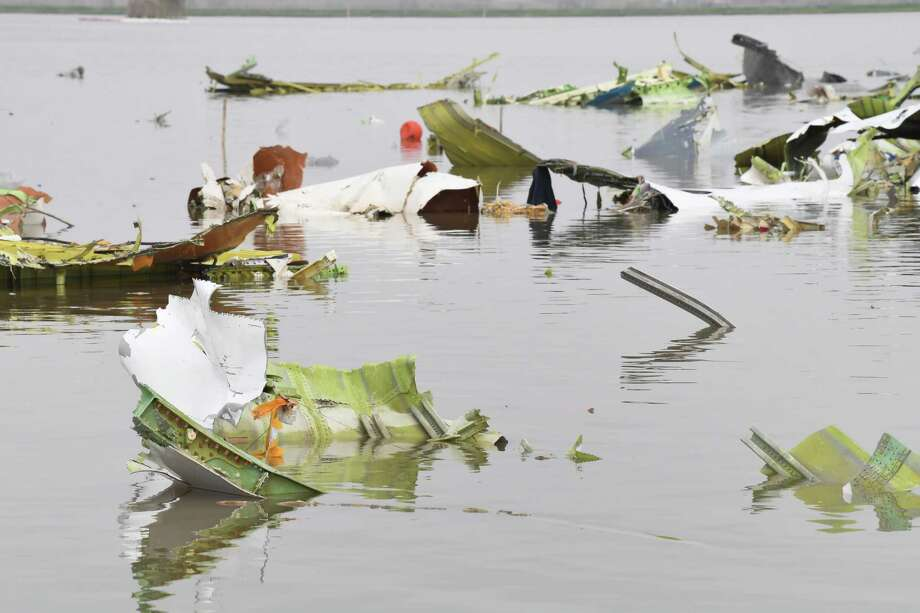 Debris from the cargo jet that crashed into Trinity Bay near Anahuac is scattered across the waters on Friday. The jet's black box was recovered Friday afternoon. Photo taken Friday, 3/1/19 Photo: Guiseppe Barranco/The Enterprise, Photo Editor / Guiseppe Barranco ©