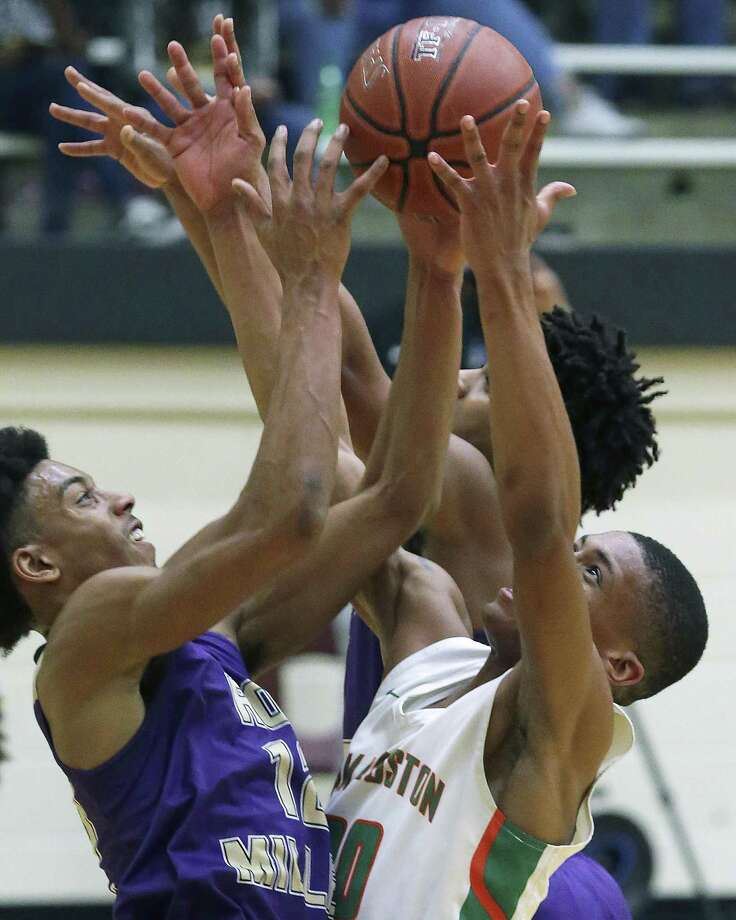 Hurricane forward Raymond Citizen battles Xavier Callandret for a rebound as Sam Houston plays Corpus Christi Miller in Region IV-5A boys basketball playoffs at Littleton Gym on Friday. Photo: Tom Reel /Staff Photographer / 2019 SAN ANTONIO EXPRESS-NEWS
