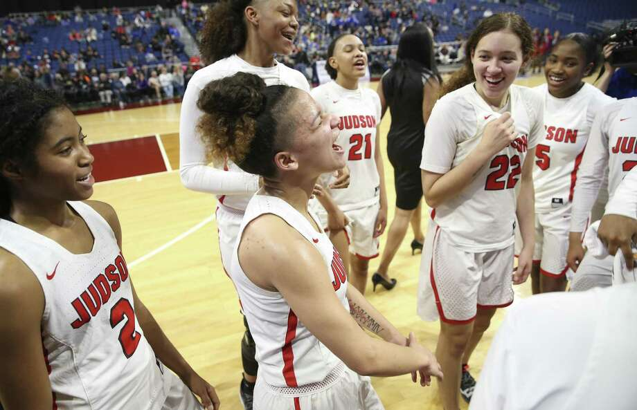 Judson's Corina Carter (03) leads the team in a victory cheer after defeating Allen in the UIL Conference 6A girls basketball state semifinal at the Alamodome on Friday, Mar. 1, 2019. The Rockets advance to the state final defeating the Eagles, 58-47. (Kin Man Hui/San Antonio Express-News) Photo: Kin Man Hui, Staff Photographer / San Antonio Express-News / ©2019 San Antonio Express-News