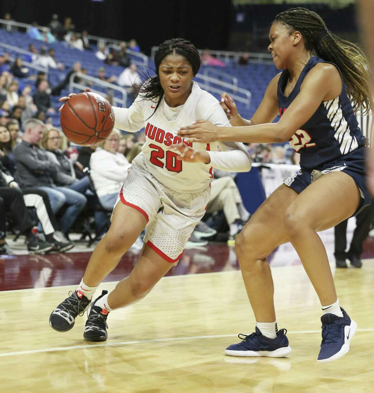 Judson's Kierra Sanderlin (20) drives toward the basket against Allen's Tyler Jackson (22) in the second half in the UIL Conference 6A girls basketball state semifinal at the Alamodome on Friday, Mar. 1, 2019. The Rockets advance to the state final defeating the Eagles, 58-47. Sanderlin was the game's high scorer with 26 points. (Kin Man Hui/San Antonio Express-News)