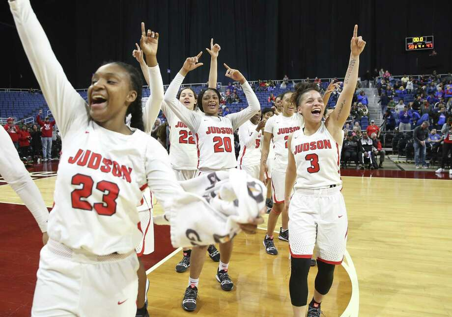 Judson's Chriresha King (23), Kyra White (22), Kierra Sanderlin (20) and Corina Carter (03) celebrate after their victory against Allen in the UIL Conference 6A girls basketball state semifinal at the Alamodome on Friday, Mar. 1, 2019. The Rockets advance to the state final defeating the Eagles, 58-47. (Kin Man Hui/San Antonio Express-News) Photo: Kin Man Hui, Staff Photographer / San Antonio Express-News / ©2019 San Antonio Express-News