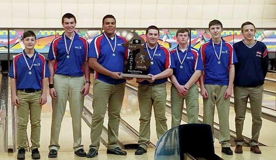 The USA bowling team poses with its Division 4 state runner-up trophy. Photo: Courtesy Of Patriot Pride Club